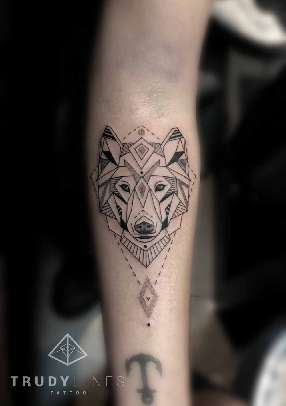 geometric wolf tattoo dotwork