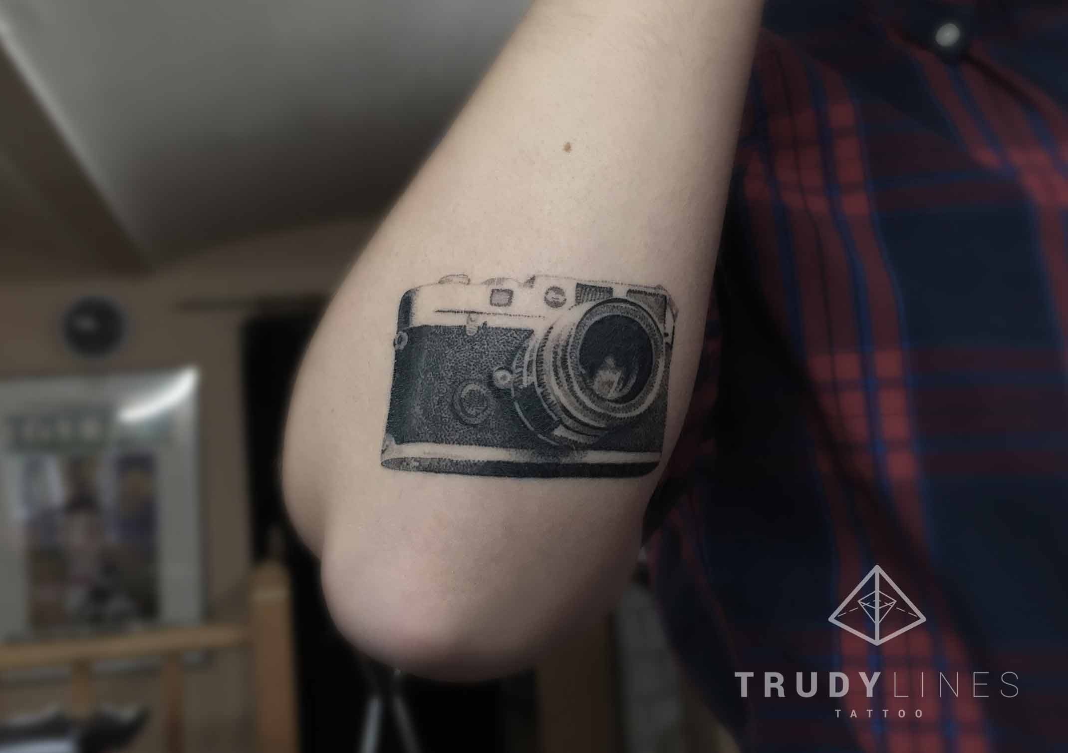 realistic dotwork camera tattoo